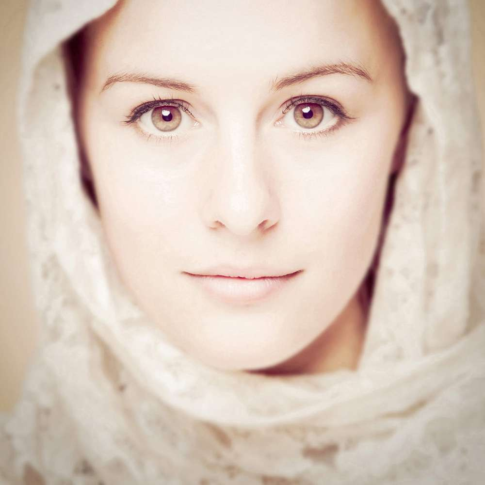 High key portrait of a young women with head scarf by Bernard Bleach Photography